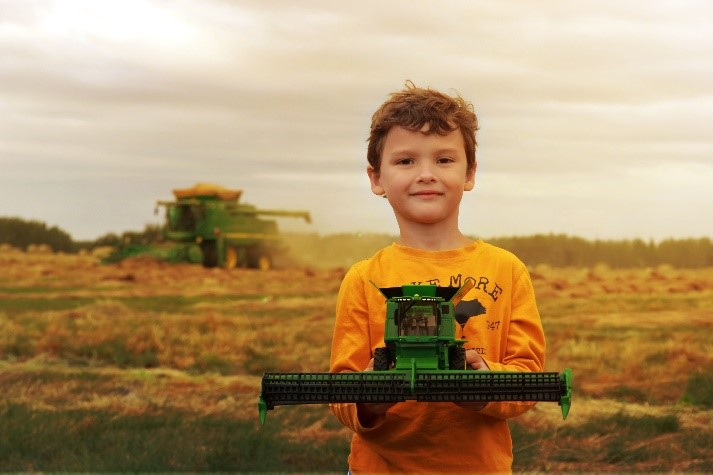 Image of young boy with combine by Anna Richard