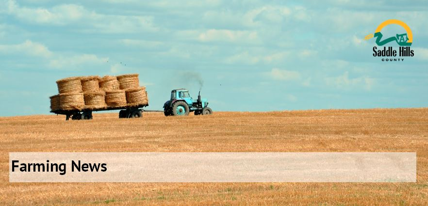 Image of tractor pulling hay on wgain
