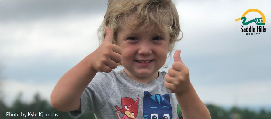Image of young boy with Thumbs Up