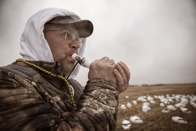 Image of hunter using goose call